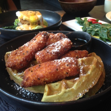 Green Tea waffles and chicken (front), Five spice pork belly benedict (back left)