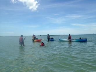 Kayaking squad on the sandbar